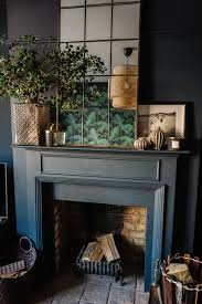 living room design from fiona duke interiors with lovely copper framed mirror botanical tropical style influences and great fireplace styling