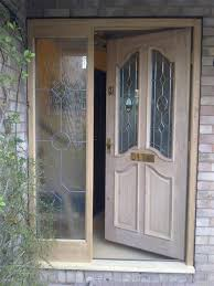 here is an example of a solid oak external door and frame we fitted with a glass side panel
