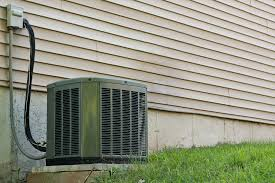 window air conditioner outside. an air conditioner connected to the outside of a home. how do conditioners work window