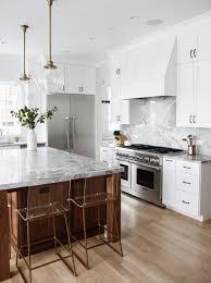 white kitchen with wood tone island