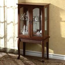 small curio cabinet with glass doors amazing small curio cabinets with glass doors for home decor