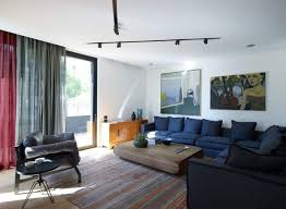 track lighting in living room. Modern Living Room With White Walls And Black LED Track Lighting In D