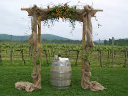 burlap wedding arbor. Decorated Wedding Arch with Burlap and Sunflowers Perfect for a