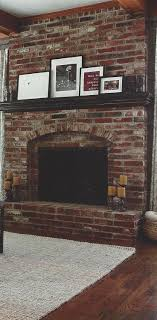except with a wood stove in it have a red brick fireplace with dark wood mantel this is a great example of how to dress it up and bring out the