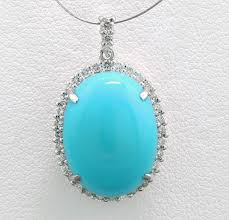 large oval turquoise and diamond pendant of 8 48 ct in 900 platinum no
