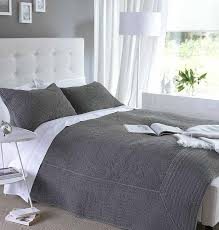 nice grey quilted bedspread