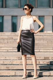 fashionable brunette businesswoman in leather pencil skirt and s stock photo images