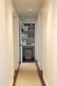 the closet came to us with wood shelving already in place we simply painted everything white and added organization linen closet 4