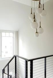 globe light chandelier staggered staircase 8