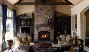 living room living room interior stone fireplace wall panel built in brown wooden shelves and brown velvet sofa set with cushions as well as designer