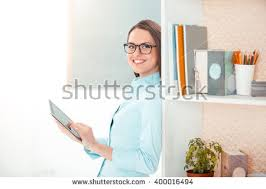 big beautiful modern office photo. beautiful young business woman in modern office with big window and cupboard full of supplies photo c