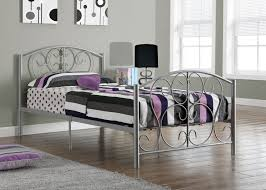 grey metal carving bed frame with headboard and black purple striped bedding set on the floor