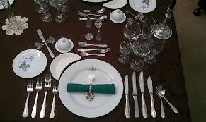 fine dining proper table service. table decorations : proper setting with complete kitchen appliances luxury display for formal dining room sets. fine service s