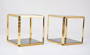 pair of gold rimmed glass side tables