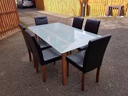 ikea frosted glass dining table   dark brown leather chairs free