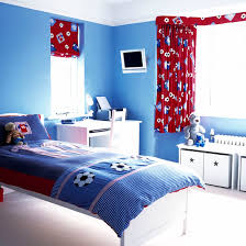 Boys' bedroom with blue and red football scheme
