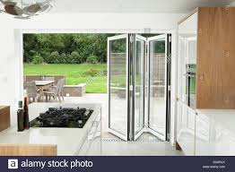kitchen with open patio doors stock image