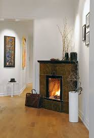 big slate tile faced gas corner fireplace