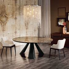 view in gallery small round dining table with a brilliant chandelier above