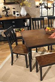 this farmhouse style table is an elegant and beautiful addition to your dining room décor sleek wood is placed against a black finish to create a homey