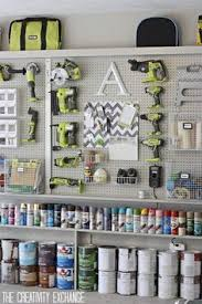 storage wall in garage with builtin shelving holding paints and spray cans below home pinterest organization4