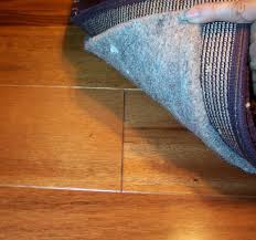 pad for area rug over carpet