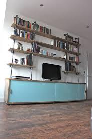 simeon reclaimed wood shelves with glass sliding doors