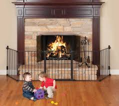gas fireplace screen two young children playing in front of a screened off fireplace