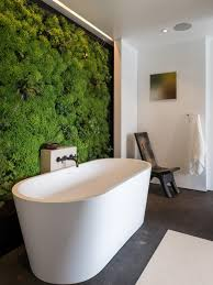 freestanding tub wall mount faucet. living wall in spa-like master bathroom freestanding tub mount faucet