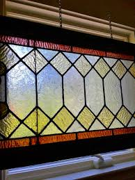 Re use stained glass hang inside with plumber chain. You get the.