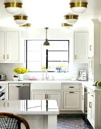 new pendant light above sink over love the idea of a hanging kitchen height lighting pictures