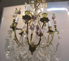 a beautiful six arm light gold gilt bronze chandelier with clear crystals and