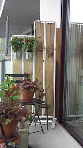 I have transformed the IKEA SOCKER plant stand to create some privacy on my  balcony.