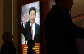 mao zedong peace and dom an image of chinese president xi jinping on display at an exhibition on the long