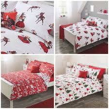 As well as sets in traditional holly colours of red & green, I also spied  this icy cool, modern village print duvet set. Without the matching  Christmas ...