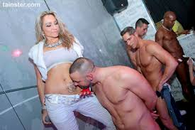 Horny party girls suck up big cock juice in sexy club orgy.