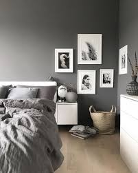 We're normally all for pure whites but there's something about this grey  bedroom that draws us in.