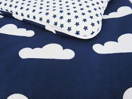 reversible nursery bedding set white clouds navy stars