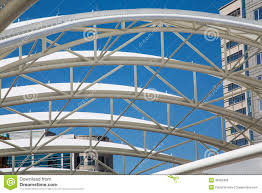 Curved Architecture White Curved Tubular Steel Architecture Under Blue Sky Stock Photo