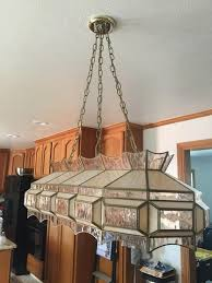 have a new light to install but i m just not sure how to attach the removal of the old light has any out there removed something like this before