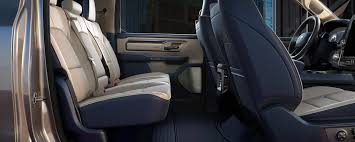 side view of tan ram 1500 passenger seating the seat covers