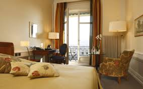 a flat screen tv a minibar and elegant parquet floors some offer views of bern s historical old town or the distant alpine peaks while others face