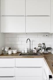 White Kitchen Tiles White Modern Kitchen Wooden Worktop Devil In The Details