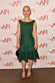 emilia clarke wearing black leather clutch multi colored leather heeled sandals green skater dress women s fashion lookastic uk