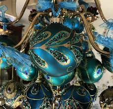 peacock ornaments decorate chandelier at
