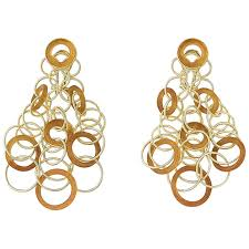 hawaii chandelier earrings composed of interlocking 18k yellow gold and carved carnelian circles of graduated size fourteen carnelian pieces weighing