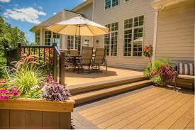 concrete patio vs wood deck cost design and ideas