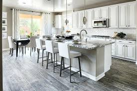 model home kitchens elegant natural stone and white cabinets toll brothers model home kitchens