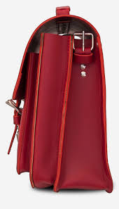 side view of red leather satchel briefcase bag with 2 gussets and asymmetric front pockets for