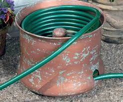 coiled garden hose storage design